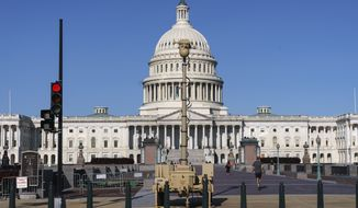 A video surveillance apparatus is seen on the East Front of the Capitol in Washington, Friday, Sept. 10, 2021, as security officials prepare for a Sept. 18 demonstration by supporters of the people arrested in the Jan. 6 riot. The camera surveillance system is on permanent loan from the U.S. Army but will be operated by the Capitol Police to enhance security around the Capitol grounds. Law enforcement officials concerned by the prospect for violence at a rally in the nation's capital next week are planning to reinstall protective fencing that surrounded the U.S. Capitol for months after the Jan. 6 insurrection there. (AP Photo/J. Scott Applewhite)