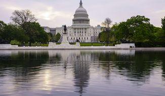 This April 28, 2021, file photo shows the U.S. Capitol building in Washington. (AP Photo/J. Scott Applewhite, File) **FILE**