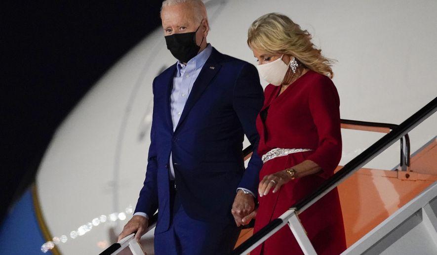 President Joe Biden and first lady Jill Biden arrive at LaGuardia International Airport, Friday, Sept. 10, 2021, in New York. (AP Photo/Evan Vucci)