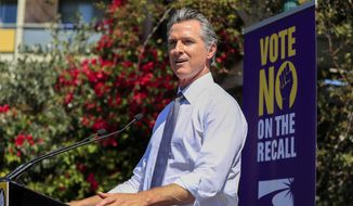 """California Gov. Gavin Newsom speaks during a rally at St. Mary's Center in Oakland, Calif., Saturday, Sept. 11, 2021. The last day to vote in the recall election is Tuesday, Sept. 14. A majority of voters must mark """"no"""" on the recall to keep Newsom in office. (Shae Hammond/Bay Area News Group via AP)"""