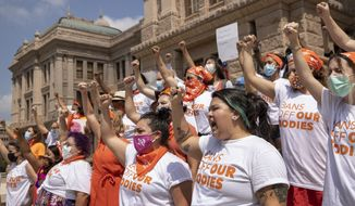In this Sept. 1, 2021, file photo, women protest against the six-week abortion ban at the Capitol in Austin, Texas. (Jay Janner/Austin American-Statesman via AP, File)