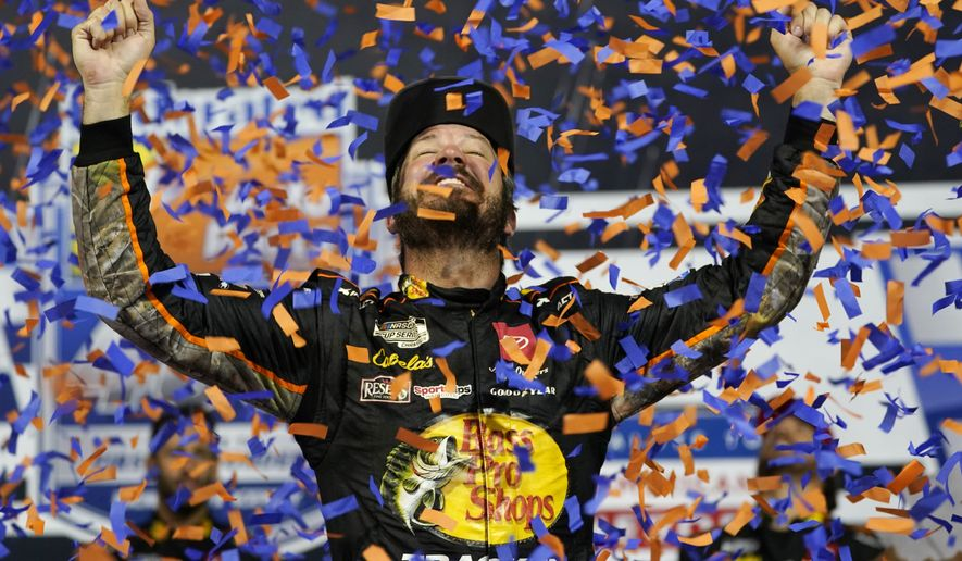 Martin Truex Jr., celebrates winning the NASCAR Cup series auto race in Richmond, Va., Saturday, Sept. 11, 2021. (AP Photo/Steve Helber)