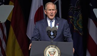 Former President George W. Bush speaks at the Flight 93 National Memorial in Shanksville, Pa., Saturday, Sept. 11, 2021, on the 20th anniversary of the Sept. 11, 2001, attacks. (AP Photo/Gene J. Puskar)