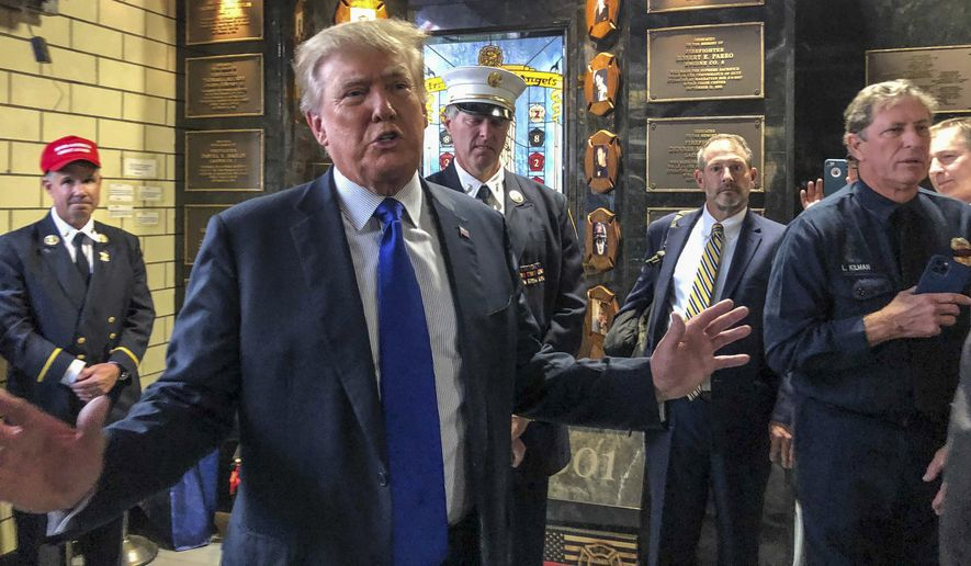 """Former President Donald Trump remembered 9/11 Saturday with a visit to New York City's Engine Co. 8 firehouse, where he praised first responders' bravery. Also on Saturday, Mt. Trump was also one of the speakers for a virtual rally sponsored by the Universal Peace Federation. The former president told participants in the """"Think Tank 2022 Rally of Hope,"""" that there is reason to be optimistic about the reunification of North and South Korea. (AP Photo/Jill Colvin)"""