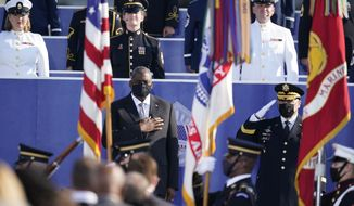 Secretary of Defense Lloyd Austin, front left, accompanied by Joint Chiefs Chairman Gen. Mark Milley, right, participates in an observance ceremony at the Pentagon in Washington, Saturday, Sept. 11, 2021, on the morning of the 20th anniversary of the terrorist attacks. (AP Photo/Alex Brandon)