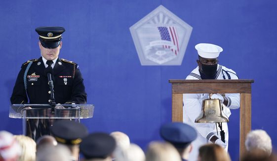 A bell is rung as names of the deceased are read during an observance ceremony at the Pentagon in Washington, Saturday, Sept. 11, 2021, on the morning of the 20th anniversary of the terrorist attacks. (AP Photo/Alex Brandon)