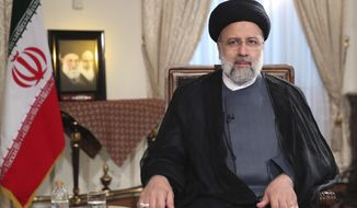 In this photo released by the official website of the office of the Iranian Presidency, President Ebrahim Raisi attends a live televised interview with state-run TV, at the presidency office in Tehran, Iran, Saturday, Sept. 4, 2021. (Iranian Presidency Office via AP)  **FILE**