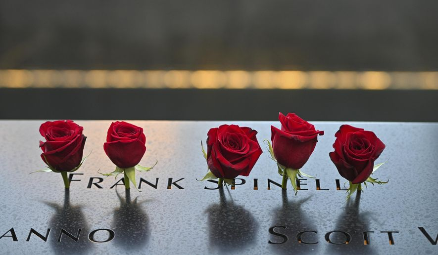 Flowers placed at the name of Frank Spinelli before ceremonies to commemorate the 20th anniversary of the Sept. 11 terrorist attacks, Saturday, Sept. 11, 2021, at the National September 11 Memorial & Museum in New York.  (Anthony Behar, Pool Photo via AP)