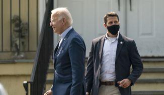 President Joe Biden, followed by a Secret Service agent, walks to a presidential vehicle after attending a Mass at St. Joseph on the Brandywine Catholic Church in Wilmington, Del., Sunday, Sept. 12, 2021. (AP Photo/Manuel Balce Ceneta)