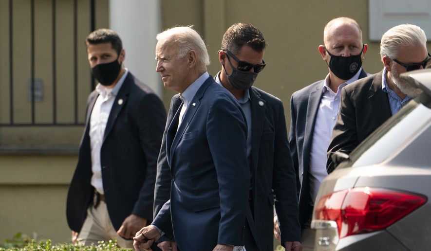 President Joe Biden, followed by Secret Service agents, walks to a presidential vehicle after attending a Mass at St. Joseph on the Brandywine Catholic Church in Wilmington, Del., Sunday, Sept. 12, 2021. (AP Photo/Manuel Balce Ceneta)