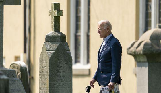 President Joe Biden walks between tombstones as he leaves St. Joseph on the Brandywine Catholic Church in Wilmington, Del., after attending a Sunday Mass, Sunday, Sept. 12, 2021. (AP Photo/Manuel Balce Ceneta)