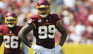 Washington Football Team defensive end Chase Young (99) looks on during an NFL football game against the Los Angeles Chargers, Sunday, Sept. 12, 2021 in Landover, Md. (AP Photo/Daniel Kucin Jr.)