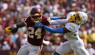 Washington Football Team running back Antonio Gibson (24) runs past Los Angeles Chargers free safety Derwin James (33) during the second half of an NFL football game, Sunday, Sept. 12, 2021, in Landover, Md. Chargers won 20-16. (AP Photo/Alex Brandon) **FILE**