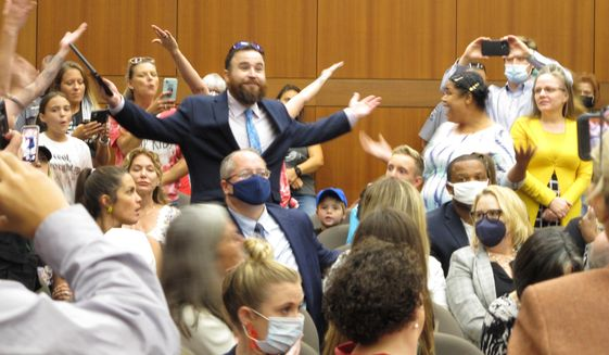 A crowd of angry, largely unmasked people objecting to Louisiana Gov. John Bel Edwards' mask mandate for schools shouts in opposition to wearing a face covering at the Board of Elementary and Secondary Education meeting, Wednesday, Aug. 18, 2021, in Baton Rouge, La.. (AP Photo/Melinda Deslatte)