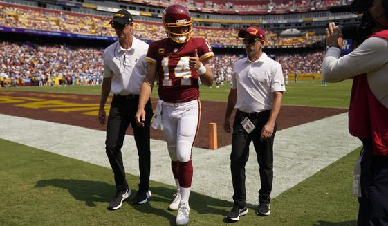 Washington Football Team quarterback Ryan Fitzpatrick (14) gives a 'thumbs-up' as he walks off field after being injured during the first half of an NFL football game against the Los Angeles Chargers, Sunday, Sept. 12, 2021, in Landover, Md. (AP Photo/Andrew Harnik)
