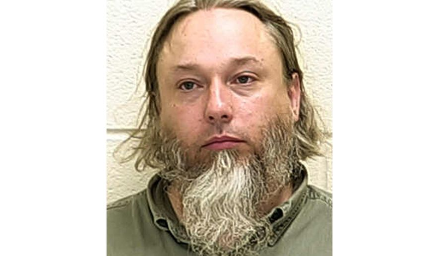 This undated file photo provided by The Ford County Sheriff's Office in Paxton, Ill., shows Michael Hari, a militia leader convicted of masterminding the bombing of a Minnesota mosque, Hari is now known by her transgender identity, Emily Claire Hari. (Ford County Sheriff's Office via AP File)
