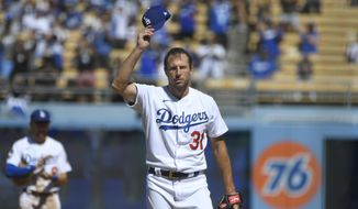 Los Angeles Dodgers Max Scherzer tips his cap after he pitched his 3000th career strikeout against San Diego Padres first baseman Eric Hosmer in the fifth inning during in a baseball game Sunday, Sept. 12, 2021, in Los Angeles, Calif. (AP Photo/John McCoy) **FILE**