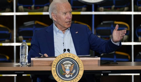 President Joe Biden speaks during a visit to the National Interagency Fire Center, Monday, Sept. 13, 2021, in Boise, Idaho. (AP Photo/Evan Vucci)