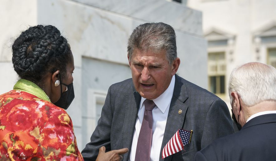 Sen. Joe Manchin, D-W.Va., speaks with Rep. Sheila Jackson Lee, D-Tex., (left) on the steps of the Capitol following a Sept. 11 remembrance ceremony, in Washington, Monday, Sept. 13, 2021. As congressional Democrats speed ahead this week in pursuit of President Joe Biden's $3.5 trillion plan for social and environmental spending, Manchin, a Democratic senator vital to the bill's fate, says the cost will need to be slashed to $1 trillion to $1.5 trillion to win his support. (AP Photo/J. Scott Applewhite)