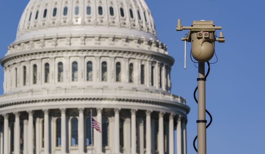 In this Sept. 10, 2021, file photo a video surveillance apparatus is seen on the East Front of the Capitol in Washington as security officials prepare for a Sept. 18 demonstration by supporters of the people arrested in the Jan. 6 riot. The camera surveillance system is on permanent loan from the U.S. Army but will be operated by the Capitol Police to enhance security around the Capitol grounds. Law enforcement officials concerned by the prospect for violence at a rally in the nation's capital next week are planning to reinstall protective fencing that surrounded the U.S. Capitol for months after the Jan. 6 insurrection there. (AP Photo/J. Scott Applewhite, File)  **FILE**