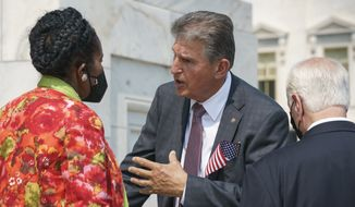 Sen. Joe Manchin, D-W.Va., speaks with Rep. Sheila Jackson Lee, D-Tex., left, and Rep. Mike Thompson, D-Calif., right, on the steps of the Capitol on Monday, Sept. 13, 2021.  (AP Photo/J. Scott Applewhite)  **FILE**