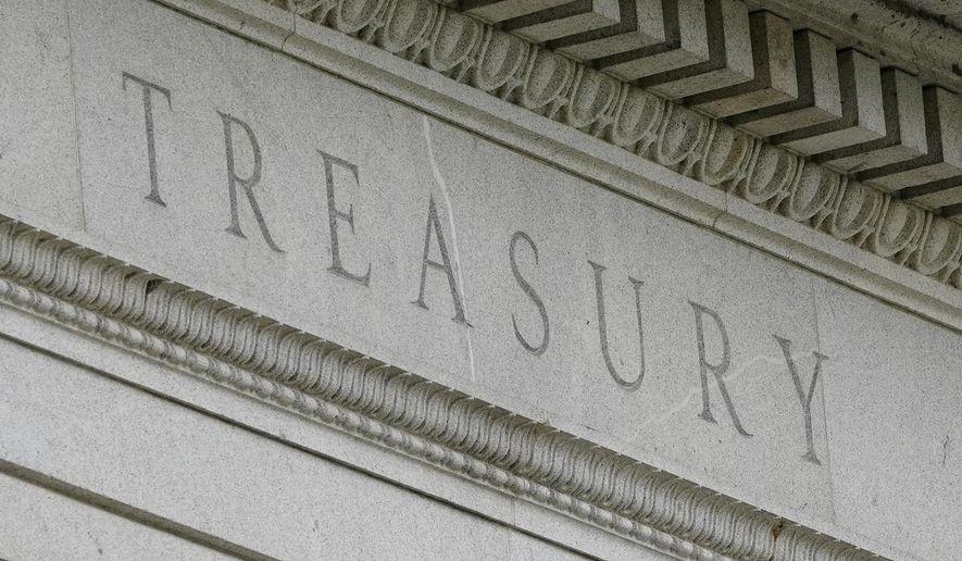 This May 4, 2021, photo shows the Treasury Building in Washington. (AP Photo/Patrick Semansky) **FILE**