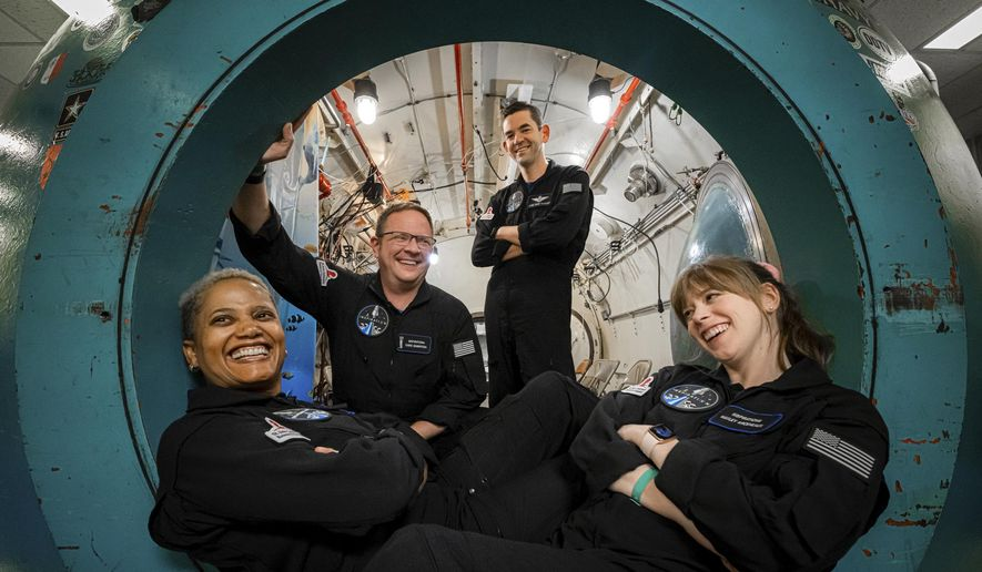 In this July 2, 2021, photo provided by John Kraus, from left, Sian Proctor, Chris Sembroski, Jared Isaacman and Hayley Arceneaux pose for a photo at Duke Health in Durham, N.C, during hypoxia training to understand how each crew member reacts in a low-oxygen environment. (John Kraus/Inspiration4 via AP)