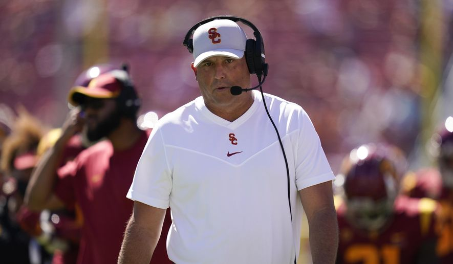 Southern California head coach Clay Helton walks on the sideline during an NCAA college football game against San Jose State Saturday, Sept. 4, 2021, in Los Angeles. (AP Photo/Ashley Landis) *** FILE**