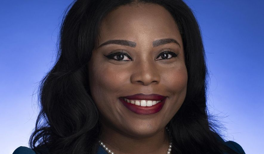 This undated photo provided by the Tennessee State Senate shows Tennessee state Sen. Katrina Robinson posing for a photo in Nashville, Tenn.  Robinson is set to go on trial, Monday, Sept. 13, 2021, on charges that she stole more than $600,000 in federal funds. (Tennessee State Senate via AP)
