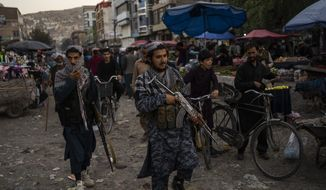 Taliban fighters patrol a market in Kabul's Old City, Afghanistan, Tuesday, Sept. 14, 2021. (AP Photo/Bernat Armangue)  **FILE**