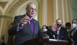 Senate Majority Leader Chuck Schumer, D-N.Y., speaks to reporters as work continues on the Democrats' Build Back Better Act, massive legislation that is a cornerstone of President Joe Biden's domestic agenda, at the Capitol in Washington, Tuesday, Sept. 14, 2021. (AP Photo/J. Scott Applewhite) ** FILE **