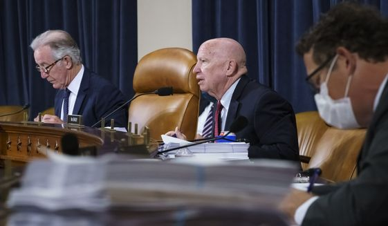 House Ways and Means Committee Chairman Richard Neal, D-Mass., left, and Rep. Kevin Brady, R-Texas, the ranking member, center right, make opening statements as the tax-writing panel continues work on the Democrats' sweeping proposal for tax hikes on big corporations and the wealthy to fund President Joe Biden's $3.5 trillion domestic rebuilding plan, at the Capitol in Washington, Tuesday, Sept. 14, 2021. (AP Photo/J. Scott Applewhite)