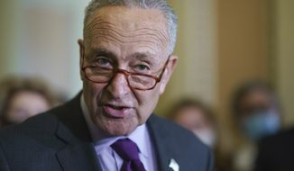 Senate Majority Leader Chuck Schumer, D-N.Y., speaks to reporters as work continues on the Democrats' Build Back Better Act, massive legislation that is a cornerstone of President Joe Biden's domestic agenda, at the Capitol in Washington, Tuesday, Sept. 14, 2021. (AP Photo/J. Scott Applewhite)