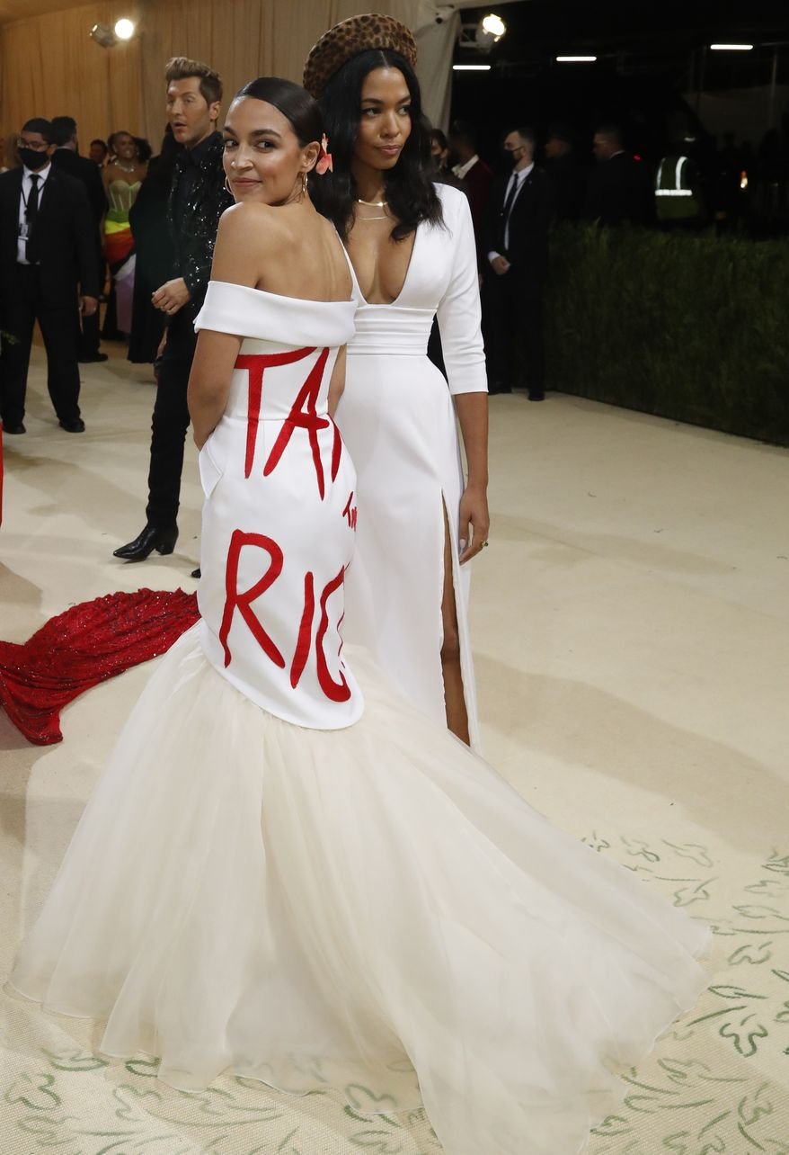 """Metropolitan Museum of Art Costume Institute Gala - Met Gala - In America: A Lexicon of Fashion - Arrivals - New York City, U.S. - September 13, 2021. Rep. Alexandria Ocasio-Cortez (D-NY) wears a """"Tax The Rich"""" dress. REUTERS/Mario Anzuoni - HP1EH9E03NL44"""