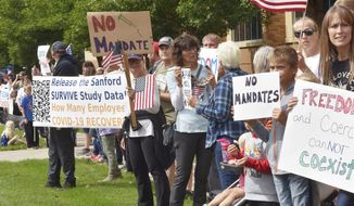People protest against Sanford Hospital's COVID-19 vaccine mandate Tuesday, Sept. 14, 2021 in Sioux Falls, S.D. (Annie Todd/The Argus Leader via AP)
