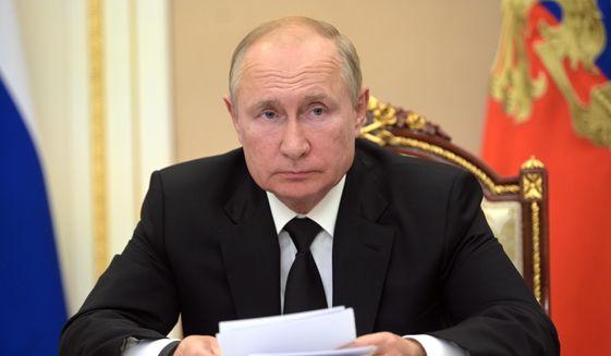 In this Thursday, Sept. 9, 2021, file photo, Russian President Vladimir Putin speaks during a meeting in Moscow, Russia. (Alexei Druzhinin, Sputnik, Kremlin Pool Photo via AP, File)