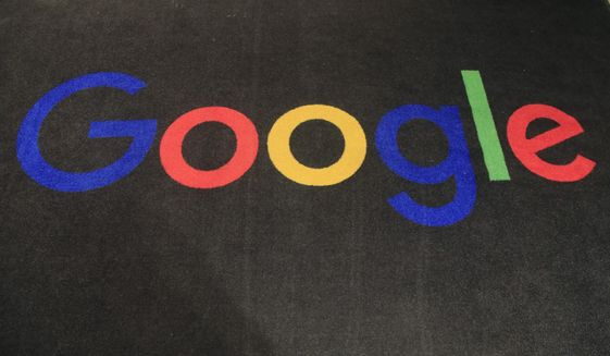 In this Monday, Nov. 18, 2019, file photo, the logo of Google is displayed on a carpet at the entrance hall of Google France in Paris. South Korea's competition watchdog says it plans to fine Google at least 207.4 billion won ($177 million) for allegedly blocking smartphone makers like Samsung from using other operating systems, in what would be one of the country's biggest antitrust penalties ever. (AP Photo/Michel Euler, File)