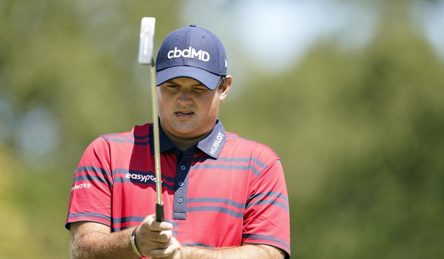 Patrick Reed lines up his putt on the second green during the third round of the Tour Championship golf tournament Saturday, Sept. 4, 2021, at East Lake Golf Club in Atlanta. (AP Photo/Brynn Anderson) **FILE**