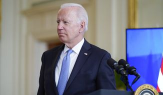 President Joe Biden, listens as he is joined virtually by Australian Prime Minister Scott Morrison and British Prime Minister Boris Johnson, to speak about a national security initiative from the East Room of the White House in Washington, Wednesday, Sept. 15, 2021. (AP Photo/Andrew Harnik)