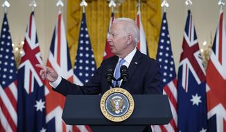 President Joe Biden, joined virtually by Australian Prime Minister Scott Morrison and British Prime Minister Boris Johnson, speaks about a national security initiative in the East Room of the White House in Washington, Wednesday, Sept. 15, 2021. (AP Photo/Andrew Harnik)