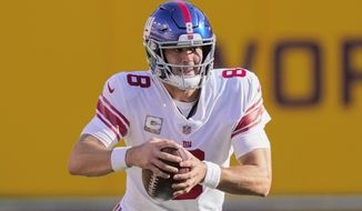 New York Giants quarterback Daniel Jones scrambles with the ball in the first half of an NFL football game against the Washington Football Team, Nov. 8, 2020, in Landover, Md. Daniel Jones is looking to stay undefeated in his career against Washington when he leads the New York Giants into the NFC East matchup on Thursday, Sept. 16, 2021. The sixth pick in 2019 is 4-0 against Washington and 4-19 against the rest of the NFL. (AP Photo/Al Drago, file)