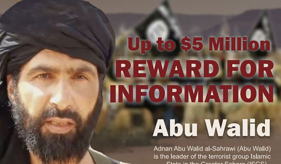 This undated image provided by Rewards For Justice shows a wanted posted of Adnan Abu Walid al-Sahrawi, the leader of Islamic State in the Greater Sahara. French President Emmanuel Macron announced the death of al-Sahrawi Wednesday, Sept. 15, 2021, calling the killing a major success for the French military after more than eight years fighting extremists in the Sahel. Macron tweeted that al-Sahrawi was neutralized by French forces but gave no further details.  (Rewards For Justice via AP)