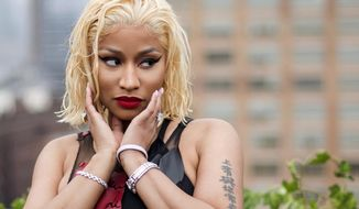 In this Sept. 11, 2018, photo, Nicki Minaj attends the Oscar de la Renta show during Fashion Week in New York. The White House is offering to connect Minaj with one of the Biden administration's doctors to address her questions about the COVID-19 vaccine. The offer comes after the Trinidadian-born rapper's erroneous tweet alleging the vaccine causes impotence went viral. (Photo by Charles Sykes/Invision/AP) **FILE**