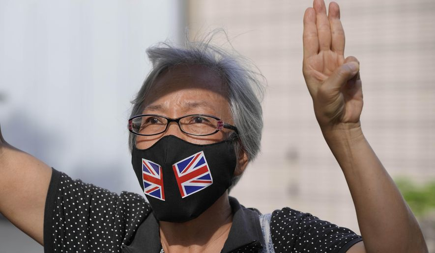 A supporter of the Hong Kong Alliance in Support of Patriotic Democratic Movements of China protests outside a court, in Hong Kong, Friday, Sept. 10, 2021. Hong Kong police charged the group that organizes the city's annual Tiananmen candlelight vigil and three of its leaders with subversion under the national security law, amid an ongoing crackdown on dissent. (AP Photo/Kin Cheung)