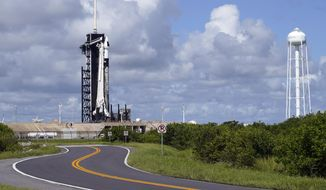 A SpaceX Falcon 9 rocket sits on pad 39A at the Kennedy Space Center in Cape Canaveral, Fla., Wednesday, Sept. 15, 2021. For the first time in 60 years of human spaceflight, a rocket is poised to blast into orbit with no professional astronauts on board, only four tourists. (AP Photo/John Raoux)