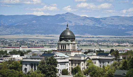 FILE - This July 2020 file photo shows the Montana State Capitol in Helena, Mont. Amid the coronavirus pandemic, Montana's legislature passed restrictive laws severely curbing quarantine and isolation powers, increasing local officials' power over local health boards, preventing limits on religious gatherings, and banning employers — including in health care settings — from requiring vaccinations for COVID, the flu or anything else. (Thom Bridge/Independent Record via AP, File)