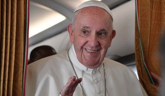 Pope Francis speaks with journalists on board an Alitalia aircraft en route from Bratislava back to Rome, Wednesday, Sept. 15, 2021, after a four-day pilgrimage to Hungary and Slovakia. (Tiziana Fabi, Pool via AP)