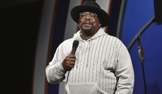 """FILE - Cedric the Entertainer performs during """"Stand Up for Haiti"""" comedy fundraiser in Los Angeles on Aug. 30, 2021. The comedian and actor will host Sunday's Emmy ceremony, airing on CBS. (Photo by Richard Shotwell/Invision/AP, File)"""