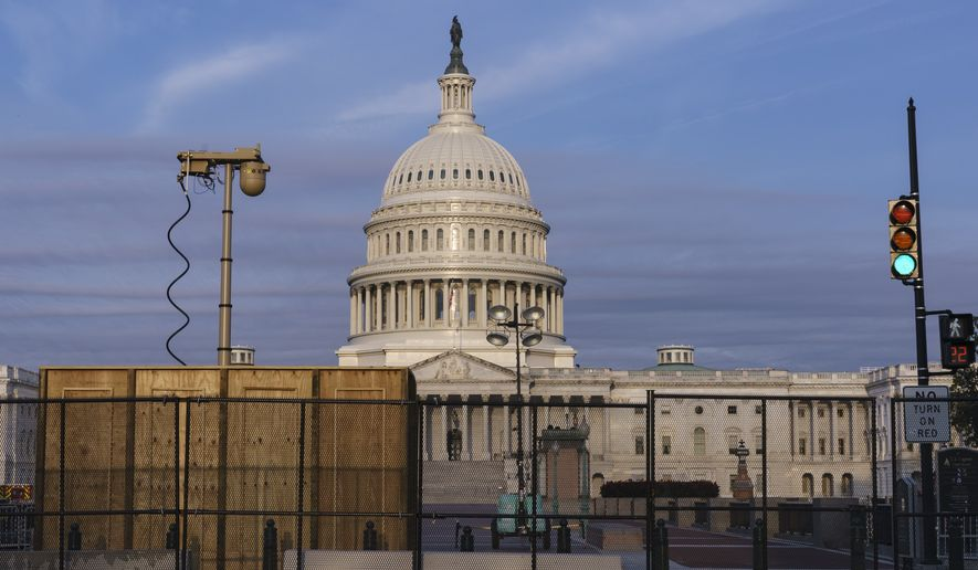 Security fencing and video surveillance equipment have been installed around the U.S. Capitol in Washington, Thursday, Sept. 16, 2021, ahead of a planned Sept. 18 rally by far-right supporters of former President Donald Trump who are demanding the release of rioters arrested in connection with the Jan. 6 insurrection. (AP Photo/J. Scott Applewhite)