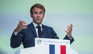 In this file photo, French President Emmanuel Macron delivers his speech during a meeting of the 'U2P', French local businesses union, in Paris, Thursday, Sept. 16 2021. (Christophe Petit Tesson, Pool Photo via AP)  **FILE**